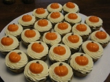 Pumpkin Cupcakes with Cream Cheese Icing and Chocolate Pumpkin Topper